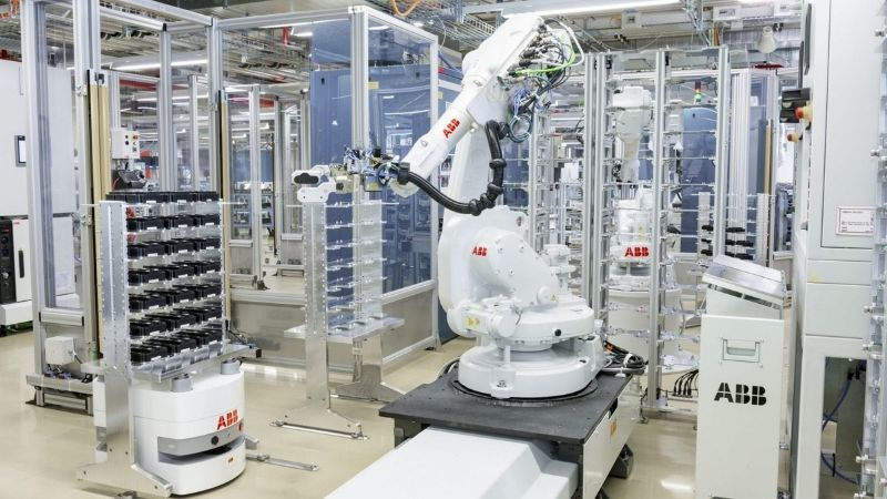 A robotic arm working in a factory